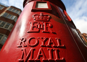 FILE - The U.K.'s 360-year-old postal service offers a majority stake to the public to help the company gain a competitive edge against European rivals. LONDON, ENGLAND - SEPTEMBER 12: A Royal Mail post box on September 12, 2013 in London, England. The Royal Mail will be privatised in the next few weeks the Government has announced. (Photo by Peter Macdiarmid/Getty Images)