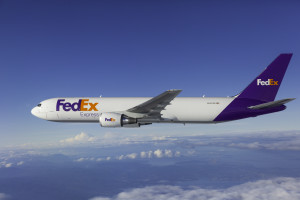 FedEx Boeing 767 freighter N107FE photographed by Chad Slattery at KPAE, and from Wolfe Air Aviation's Learjet 25B over Washington State, on September 26, 2014.