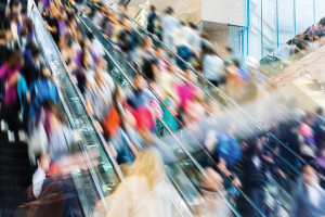crowed people in blurred motion on Escalator.