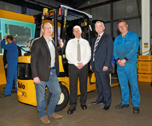 Yale 400K Handover – (l-r) Rod Hogg, logistics manager, Oxfam; Neil Turkington, trainer, Yale; Jonathan Bell MLA and Yale production operator Eddie Smart.