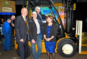 Yale 400K rolls of production at Craigavon (l-r) Harry Sands, managing director EMEA Hyster-Yale Group; Rod Hogg, logistics manager, Oxfam; Jonathan Bell MLA Minister of the Department of Enterprise Trade and Investment; and Alison Hopkinson, Oxfam finance director.