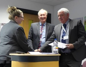 Laura Nelson md RTITB with Mike Williams CEO RTITB presents Denby transport, Terry Rose first ever RTITB certificate for train the trainer.