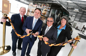 Luis Arriaga, president UK, Ireland & Nordics, cuts the ribbon to open UPS Integrad. Picture by: Shawn Ryan